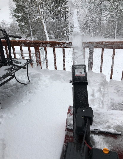 Clearing snow from the back deck of HQ.